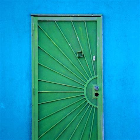 green door on blue wall photograph by block collections
