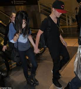 Shy arrival justin and selana arrived back in the u s today jetting