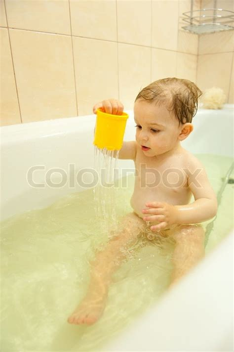 And Boy In The Bathroom by Boy Is With Water In Bath Stock Photo Colourbox