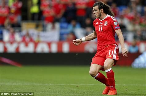 balesold hairstyle on gareth bale shows off his lengthy locks as wales draw