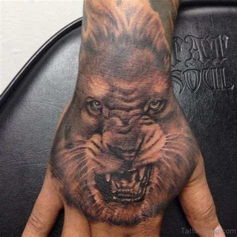 lion tattoo on hand 38 tattoos on