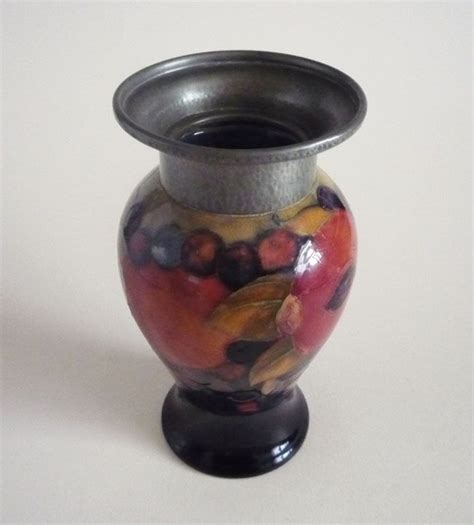 william moorcroft pomegranate vase with tudric pewter c1920