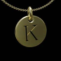 gold cut out initial letter k disc pendant 14 5mm
