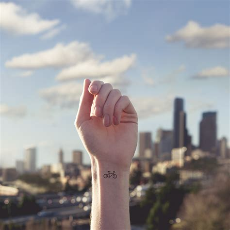 designboom tattoo austin tott pairs tiny tattoos with parallel landscapes