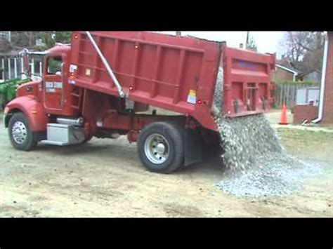 Truck Load Of Gravel Dumping Load Of Gravel