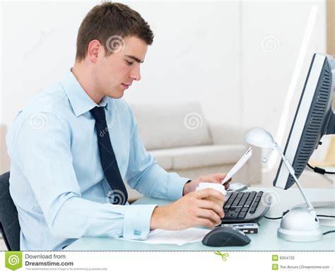 Desk Reading Smart Business At Office Desk Reading Paper Stock