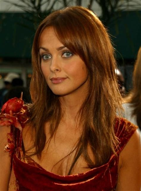 actress with long tapered face izabella scorupco wearing her long textured hair open and