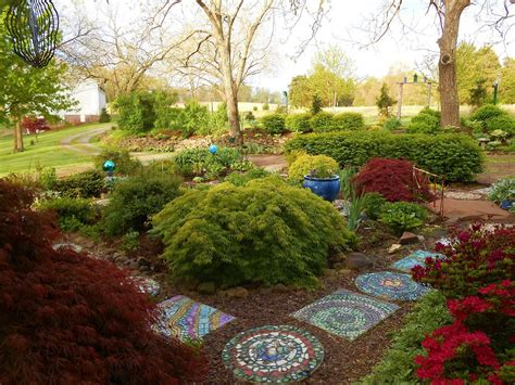 Garden Stepping by Creating Mosaic Stepping Stones In Your Garden