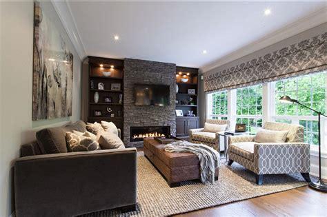 rustic den w wine room floor to ceiling fireplace