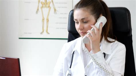 doctor the phone doctor talking on the phone in office stock footage
