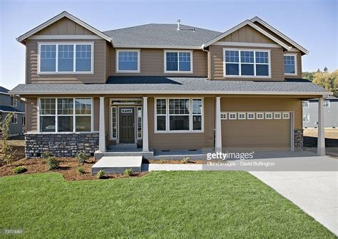 image of a house front of house with lawn and driveway stock photo getty