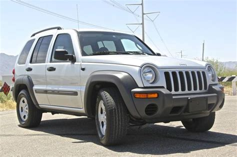 how cars run 2004 jeep liberty head up display service manual how to replace 2004 jeep liberty outside door handle recall alert 2003 jeep