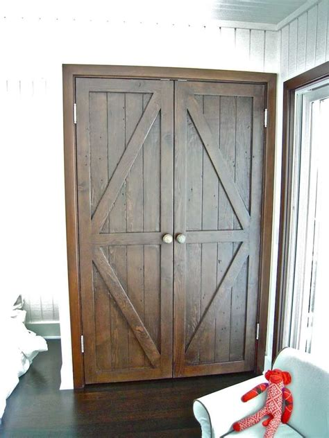 made custom reclaimed wood bi fold closet doors for a