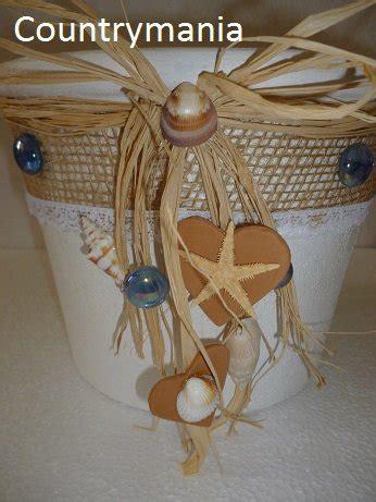 vasi con conchiglie vaso di terracotta in stile shabby con conchiglie e