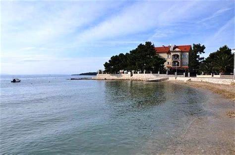 immobilien ferienwohnung kaufen insel rab wohnung direkt am strand mit bootsanleger