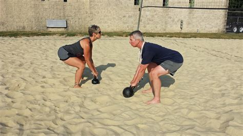 partners swinging kettlebell swings partner workout seven stars fitness