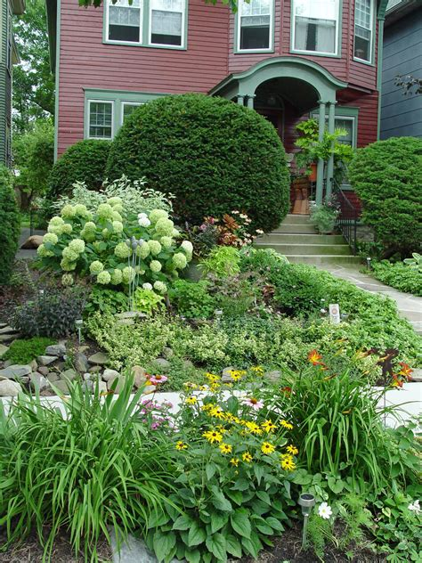 front yard garden plants blooming neighbors garden housecalls