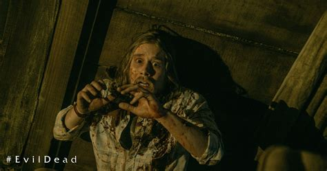 Reading Evil Book In Cabin by Gruesome New Still And Redband Trailer From The Evil Dead