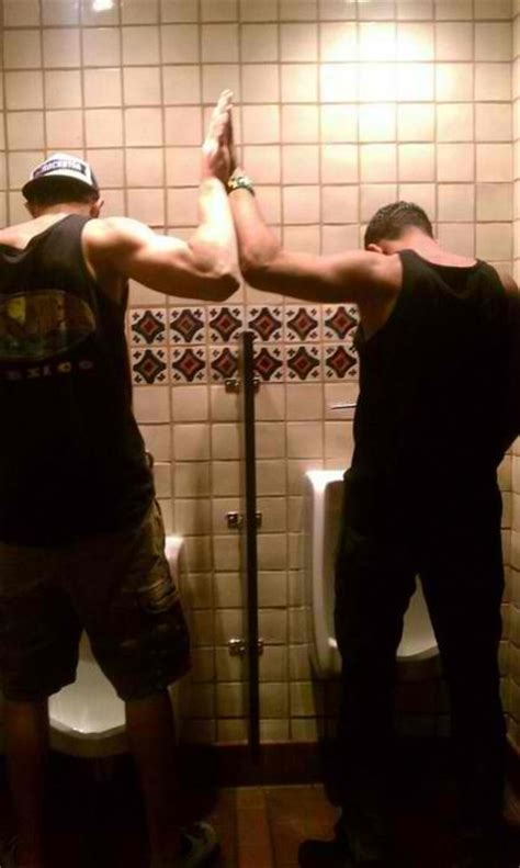 bathroom wall gay high 5 that s hot urinal the men who pee together stay