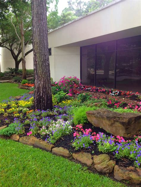 landscape design with beautiful moss rock borders boulder