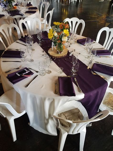 Ivory table linens with eggplant napkins and runners
