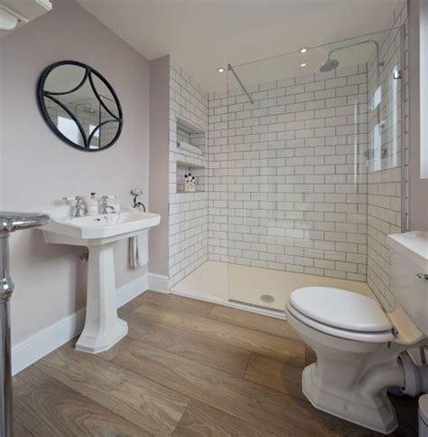 bathroom wood floor tile walls light purple bathroom walls white subway tile shower