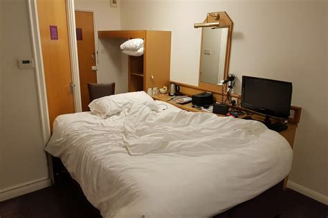 29 premier inn rooms businessman rearranges premier inn hotel room so he can charge phone in bed the independent