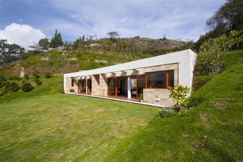 House Built Into Mountain by Ar C Architects Carves House Gazebo Into The Side Of A