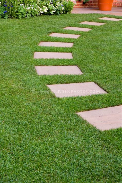 stepping stones for backyard stepping stones in perfect lawn grass leading in an arc