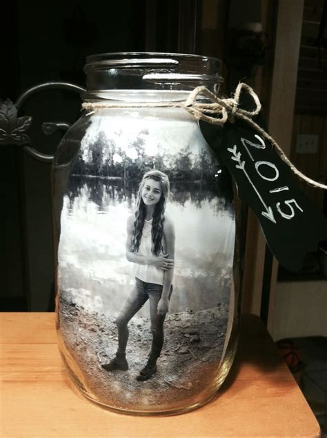 graduation centerpieces for guys jar centerpiece for graduation i put 2 pictures in