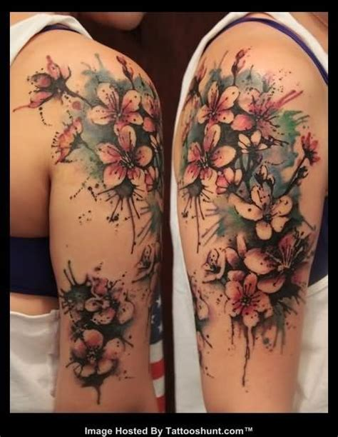 half sleeve watercolor tattoo of different flowers abstract flowers color ink tattoos on half sleeve