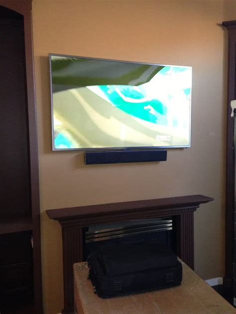 sound bar on top or below tv tv and sound bar above fireplace yelp