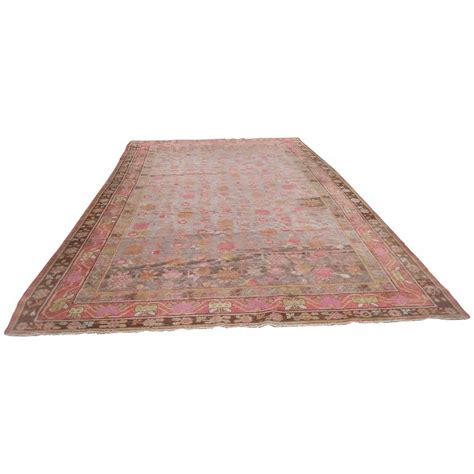 rugs band antique khotan rug with eight band border in browns and oranges for sale at 1stdibs