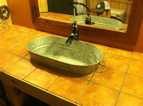 our new rustic western bathroom sink faucet new home ideas rustic bathrooms