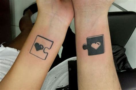matching wrist tattoos couples puzzle tattoos on wrist for