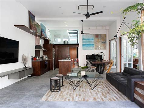 Open Plan Kitchen And Living Area by Terrace House Turned Into A Modern Family Residence