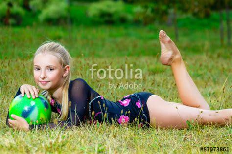 junior pt preteen quot outdoor portrait of young cute little girl gymnast