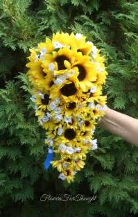 cascading  waterfall sunflower bouquet yellow  blue