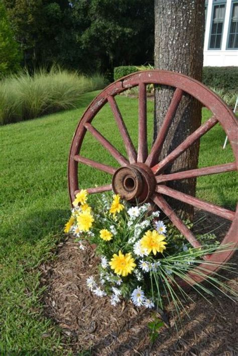 Pictures Of Wedding Wagons For Flower by Picture Of Wagon Wheel Decorated With Flowers