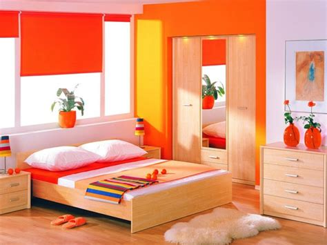 orange bedroom color ideas with light wooden flooring and