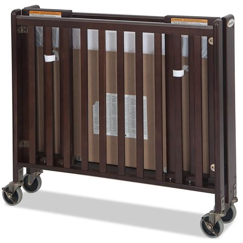Foundations Hideaway Folding Crib by Foundations Hideaway Easyroll Wooden Folding Crib In