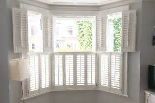 Window Treatment For Bow Window bay window interior shutters design inspiration window
