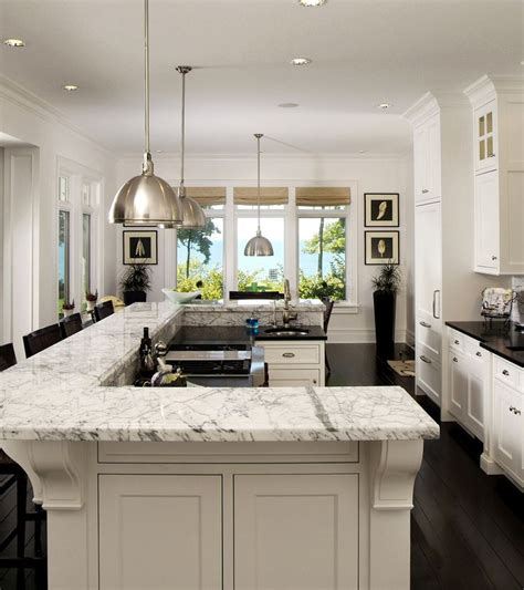 u shaped kitchen layout with island the design of this island bi level u shaped island
