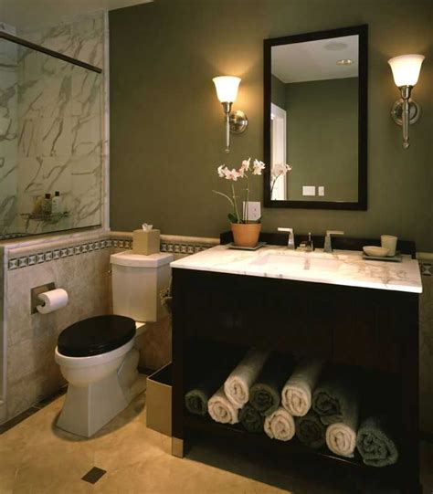 powder room with black vanity marble tile green walls for the home