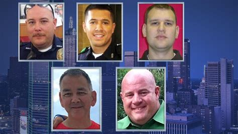 Dallas Officer by Families Mourn The Loss Of Five Officers Killed In