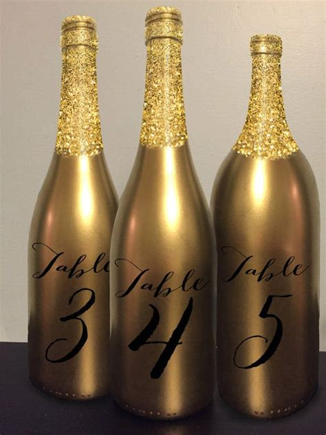 wedding centerpieces wine bottles table number wine bottle gold glitter wedding centerpiece