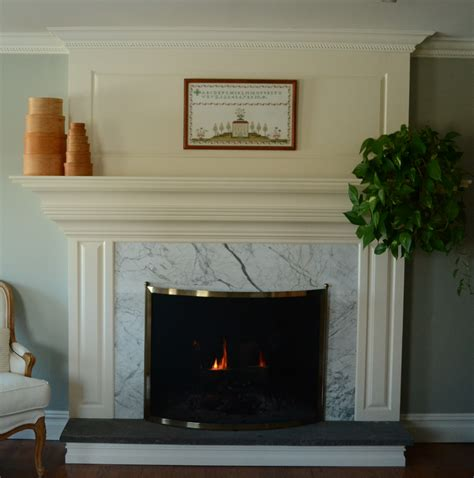 Black And White Fireplace Tiles by White Fireplace With White Tile Surround And Black Hearth