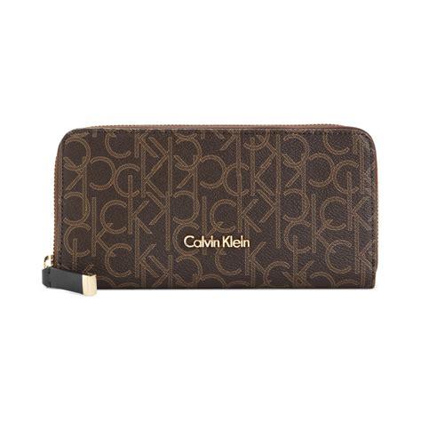 Calvin Klein Ck Wallet calvin klein monogram wallet in brown brown khaki camel
