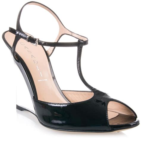 casadei clear heel wedge shoe in black lyst