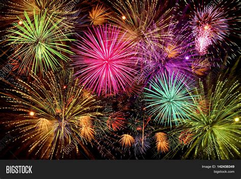 colorful firework celebration on dark night sky background